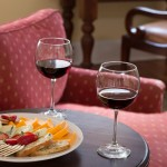 Wine glasses and cheese and crackers plate