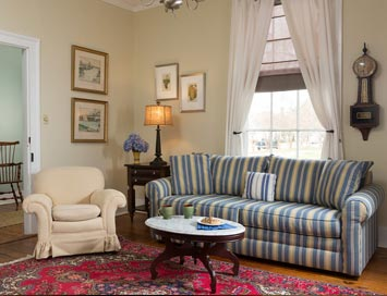 Tillie Bond Suite sitting room with couch and chair, at our pet friendly inn in Edenton, NC