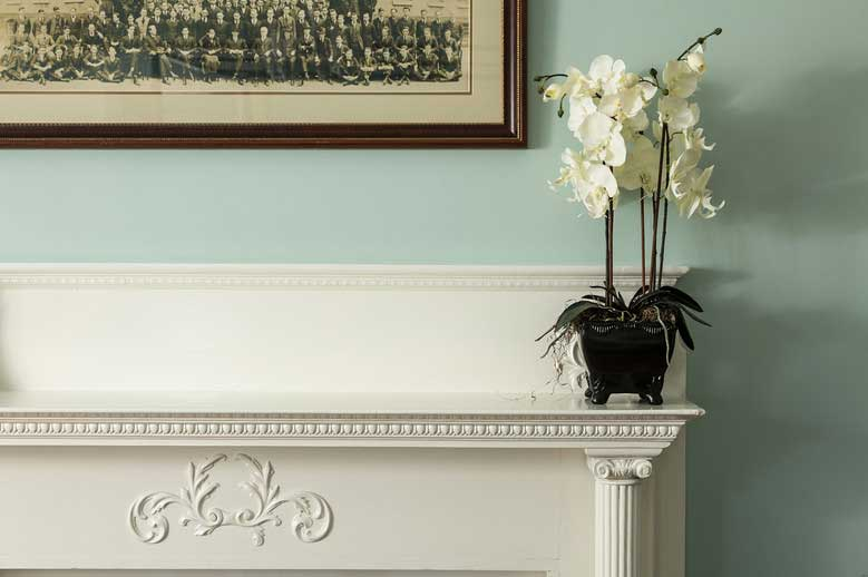 Details of the artwork on the fireplace surround in the Charles Eden Suite at our Inner Banks Getaway