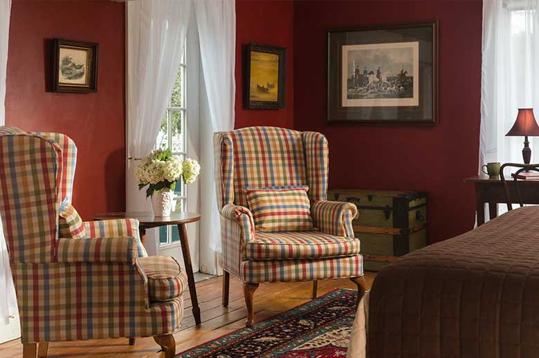 Romantic North Carolina Bed and Breakfast - Chowan Room with two high back wing chairs - ADA Accessible