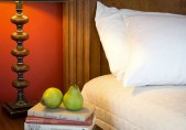 Romantic North Carolina Bed and Breakfast - Chowan Room details, close up of pillow, pears and books - ADA Accessible
