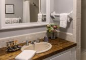 Hotel in Edenton North Carolina the Drummonds Point Room bathroom with vanity, sink and large mirror