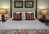Drummonds Point Room in our Hotel in Edenton North Carolina - Close up of the bed from the footer with pillows and lamps
