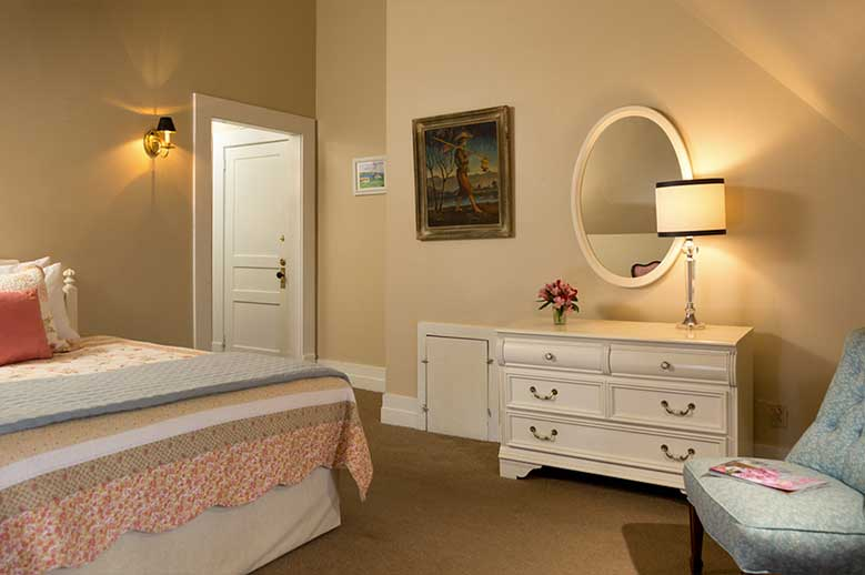 Harriet Jacob Suite at our Edenton Inn view the bottom of the bed and white chest-of-draws