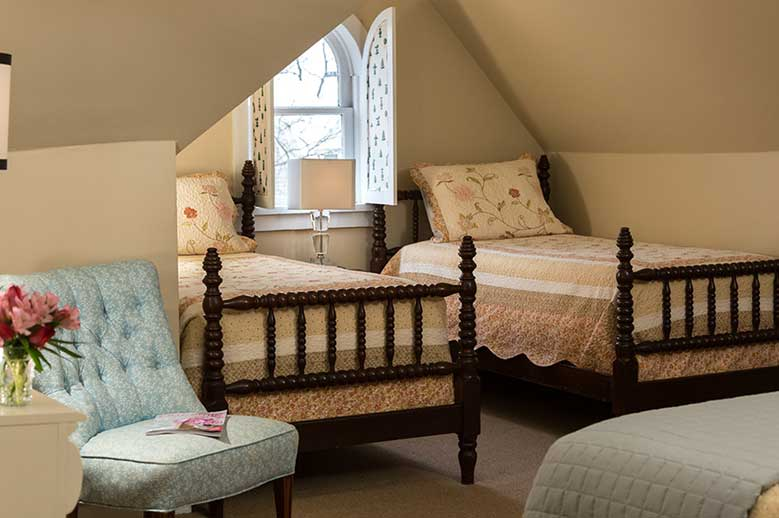 Harriet Jacob Suite at our Edenton Inn view of the two single beds with the attic window