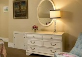 Harriet Jacob Suite at our Edenton Inn view of the white chest-of-drawers with big mirror