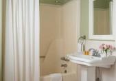 North Carolina Getaway B&B bathroom in the Joseph Hewes Suite, antique pedestal sink with bathtub and shower.