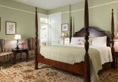 Joseph Hughes Suite - view of the four-poster bed, chairs and side table