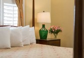 Two room Suite for your Romantic North Carolina Vacation, close up of pillows, lamp and flowers in bedroom