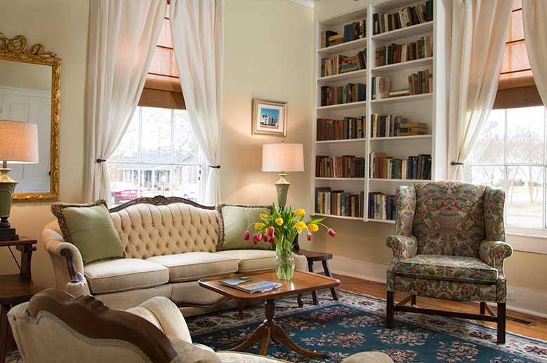 Two room Suite for your Romantic North Carolina Vacation, classically appointed sitting room with couch, chairs, library