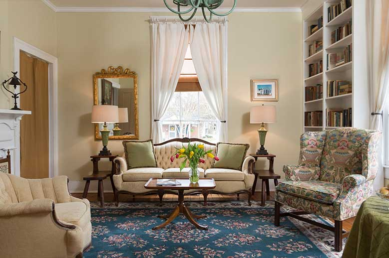 Two room Suite for your Romantic North Carolina Vacation, sitting room with couch, chairs, library