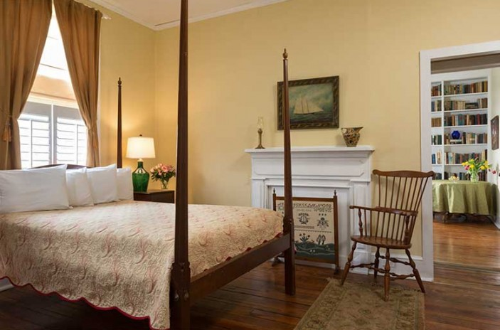 Two room Suite for your Romantic North Carolina Vacation, four poster queen bed, chair and fireplace