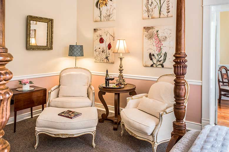Penelope Barker Suite at our North Carolina Bed and Breakfast, relax in two classic white chairs with foot stool