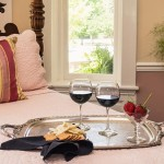 Close up of the Loft, wine and crackers on a tray on the bed