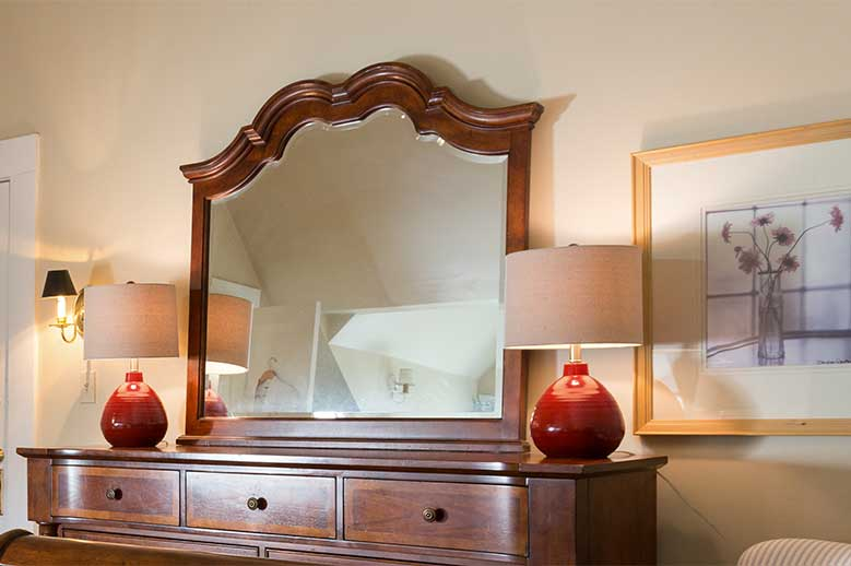 Edenton, NC hotel Samuel T. Sawyer Family Suite, view of the antique bureau with large mirror