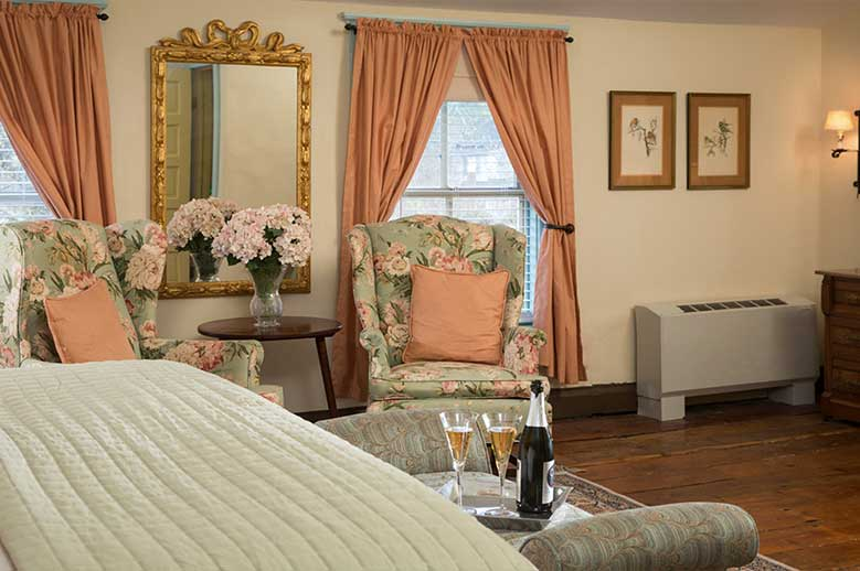 Romantic North Carolina Inn Sandy Point Suite, Champagne toast at the foot of the bed, perfect honeymoon suite