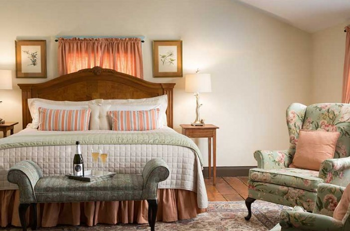 Romantic North Carolina Inn a Large room, King bed with foot bench, wine tray and highback wing chairs