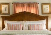 Romantic North Carolina Inn Sandy Point Suite, close up of bed with antique headboard