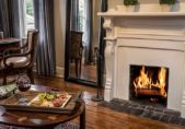 North Carolina B&B Honeymoon Suite, fruit and cheese plate in front of fireplace with roaring fire