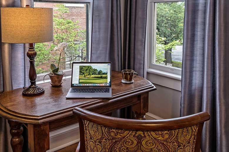 North Carolina B&B Honeymoon Suite, desk and chair with laptop and lamp