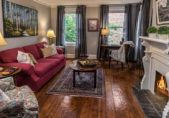 North Carolina B&B Honeymoon Suite, sitting room with full sized couch, chairs, desk and fireplace