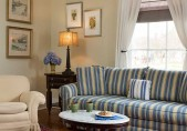 Romantic North Carolina Lodging - Pet Friendly Sitting Room with large couch, coffee table and easy chair