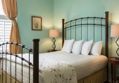 Romantic North Carolina Lodging - Pet Friendly bedroom with iron frame bed