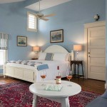 Romantic North Carolina Hotel, Yeopin Suite with Cathedral Ceilings, King bed, table with wine and glasses