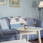 Romantic North Carolina Hotel, Yeopin Suite close view of loveseat and table with wine and glasses