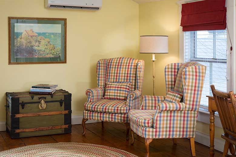 Albemarle Suite, Romantic Getaways in North Carolina. Two winged highback chairs in checked fabric and chest