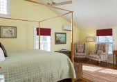 Albemarle Suite, Romantic Getaways in North Carolina. View from side of bed towards two highback wing chairs