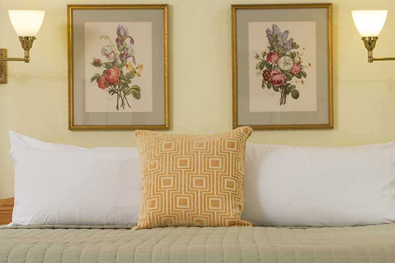 Albemarle Suite, Romantic Getaways in North Carolina. Details, prints of flowers above the bed with pillow
