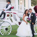 Wedding, bride, groom and horse carriage at Inner Banks Inn