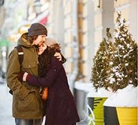 Buy two nights get one free offer, couple enjoying the winter outside