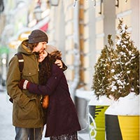 Couple hugging in the street enjoying winter in North Carolina